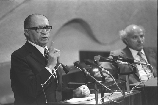 Menachem Begin speaking in the Knesset (Photo from Government Press Office-Wikimedia Commons).