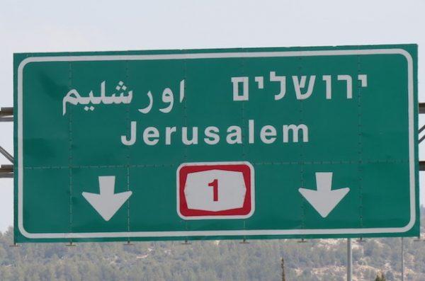 An Israeli road sign that omits Jerusalem's Arabic name ('Al-Quds'), instead using the Hebracized Urshalim.