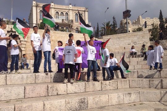 Palestinian children from the East Jerusalem neighborhood of Silwan demonstrate against the route of the Jerusalem Marathon, which led to a closure on Palestinian neighborhoods in the city.