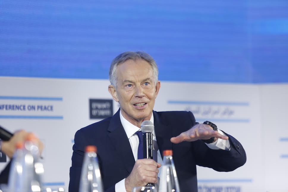 Former British Prime Minister Tony Blair is interviewed by Haaretz columnist Ari Shavit at the Haaretz Conference on Peace, Tel Aviv, November 12, 2015. (photo: Tomer Appelbaum)
