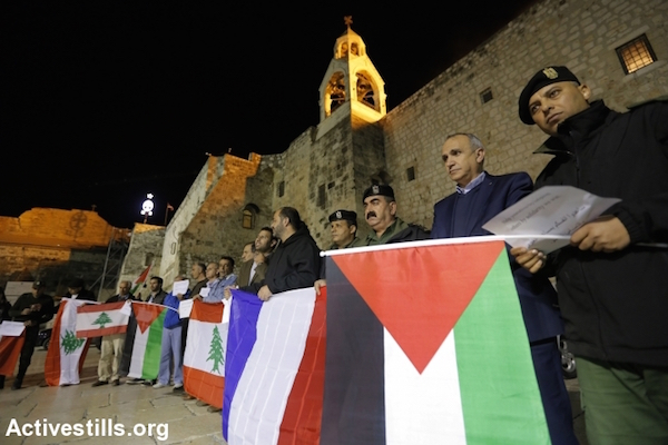 Palestinians take part in a solidarity vigil following the terror attacks in Beirut and Paris that killed 43 and 130 respectively, Bethlehem, West Bank, 14 November, 2015. (Mustafa Bader/Activestills)
