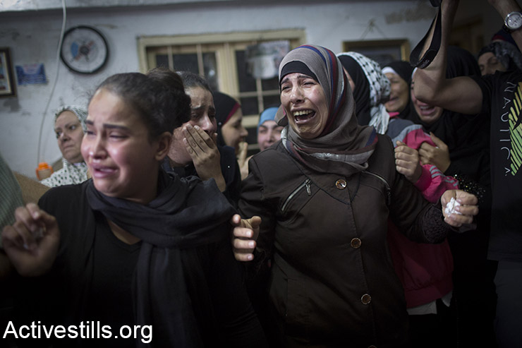 Relatives mourn during the funeral of 13-year-old Palestinian Ahmad Sharake, who was shot dead by Israeli soldiers during clashes near the Beit El Jewish settlement yesterday (Oct. 11), in the Palestinian West Bank refugee camp of Jalazun, on the outskirts of Ramallah, October 12, 2015. Sharake was killed during clashes that broke out as hundreds of Palestinians near Ramallah attempted to approach a road to throw stones and firebombs at settlers' cars. (Activestills.org)