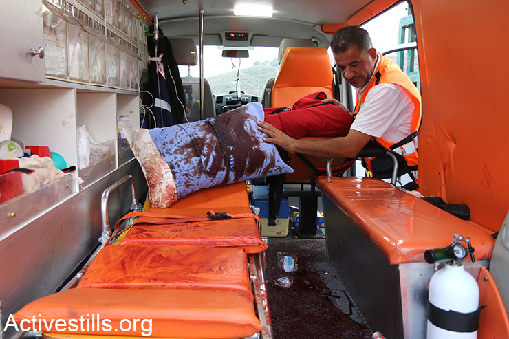 A Palestinian ambulance seen bloodstained after a day of clashes between Palestinian university students and Israeli forces at Huwwara checkpoint, Nablus, West Bank, October 12, 2015. About 19 Palestinians were injured with live bullets. (Activestills.org)