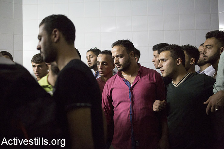 Palestinians mourn Mutaz Ibrahim Zawahreh, 27, from Deheishe camp, in Beit Jala Governmental hospital, West Bank, October 13, 2015. Zawahreh was killed by an Israeli soldier, during a protest in front of the Separation Wall in Behlehem. Tensions rise in recent weeks with violent attacks by both Israelis and Palestinians and clashes around the West Bank, Jerusalem and Palestinian towns inside Israel. (Activestills.org)