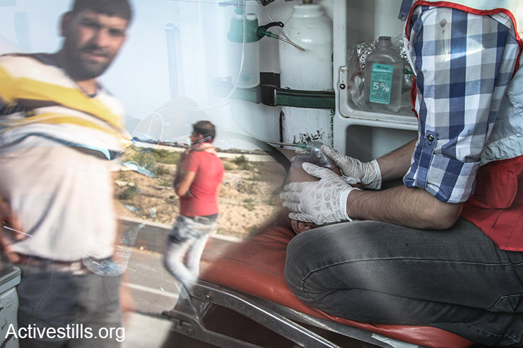 Palestinian protesters are seen in a reflection on an ambulance where an injured Palestinian is treated during a protest near the Gaza border at the proximity of Erez crossing, Northern Gaza Strip, October 23, 2015. Tensions rise in recent weeks with violent attacks by both Israelis and Palestinians and clashes around the West Bank, the Gaza Strip, Jerusalem and Palestinian towns inside Israel. Since the beginning of October, 57 Palestinians have been killed in shootings and clashes with Israeli forces in the occupied Palestinian territories and Israel, while eight Israelis have been killed in knife and gun attacks. (Activestills.org)