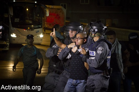 Policemen arrest a protesterduring clashes between youth and Israeli forces in the Palestinian town of Nazareth in northern Israel,on October 8, 2015. (Activestills.org)