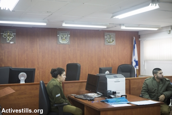 Israel soldiers in a courtroom at the Ofer Military Court near the West Bank town of Beitunia, February 8, 2015. (Oren Ziv/Activestills.org)