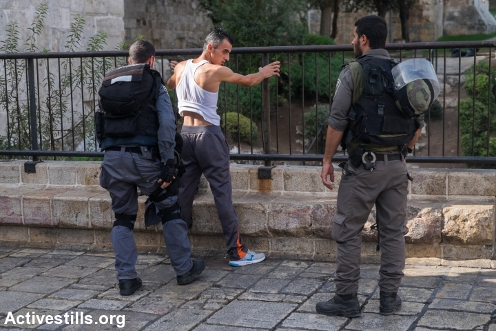 Israeli policemen search a Palestinian man at Damascus gate, in Jerusalem's old city, October 18, 2015. Israel set up checkpoints in the Palestinian neighbourhoods of east Jerusalem and mobilised hundreds of soldiers as a collective punishment after recent attacks by Palestinians. (photo: Yotam Ronen/Activestills.org)