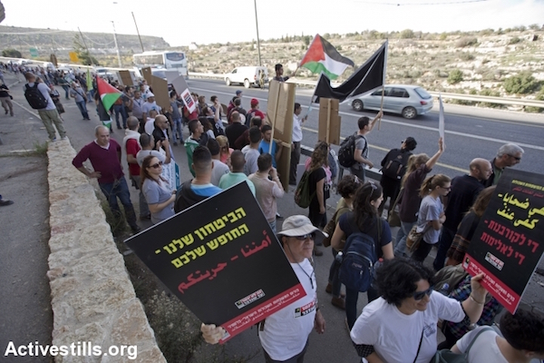 Anti-occupation protesters march along the side of Route 60 in the West Bank, November 27, 2015. (Mustafa Bader/Activestills.org)