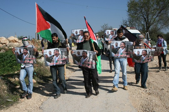 Palestinians, Israelis and internationals march in Bil'in to commemorate one year since the death of PA Minister Ziad Abu Ein, December 10, 2015. (photo: Haggai Matar)