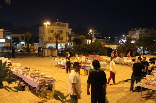 "Students organizing donated books as part of the ""Kitabi Kitabak"" (""my book is your book"") program of the Academiyu al-Tira. (Photo courtesy of the Academiyu al-Tira)."