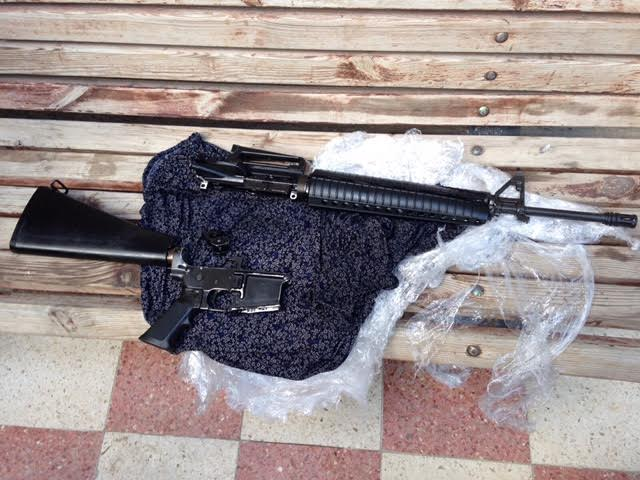 An M-16 rifle confiscated by Israeli forces during a home demolition in Shuafat refugee camp, December 2, 2015. (photo: Israel Police)