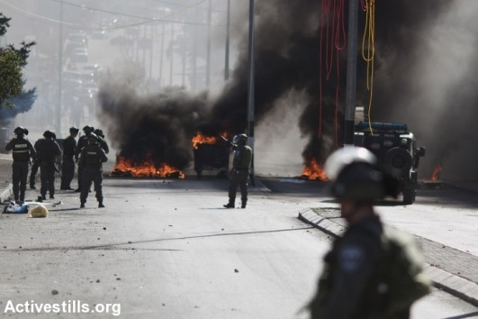 Israeli border policemen are seen during clashes with Palestinian youths in the West Bank city of Bethlehem, November 13, 2015. (Mustafa Bader/Activestills.org)