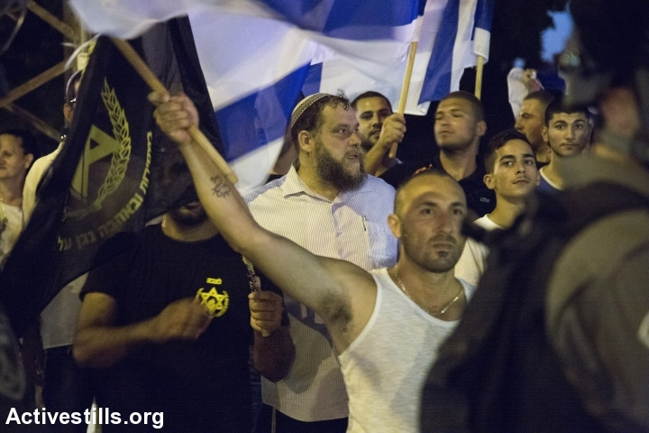 File photo of Lehava leader Benzi Gopstein with his supporters at a right-wing protest. (Photo by Keren Manor/Activestills.org)