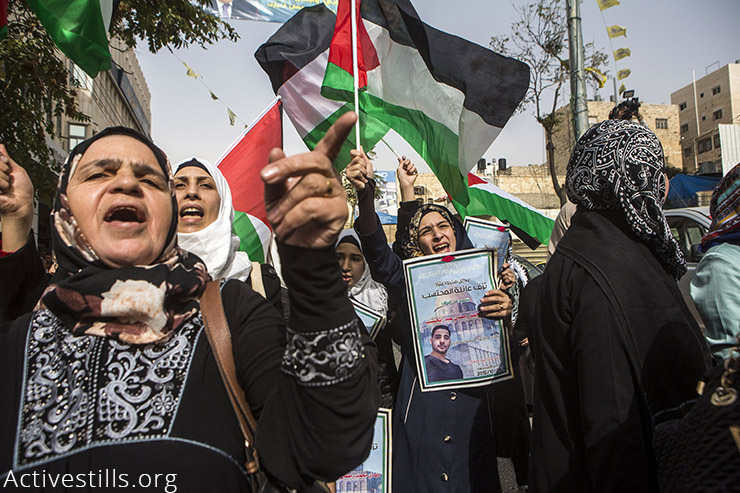 Women chant slogans and hold posters commemorating the Palestinians killed by Israeli forces last month, during a demonstration calling for the release of their bodies, Hebron, West Bank, November 4, 2015. Israel is still holding some of the bodies of Palestinians the army claims conducted attacks against Israeli forces. Since October 1st, Israelis have killed over 100 Palestinians and Palestinians have killed some 20 Israelis. (Activestills.org)