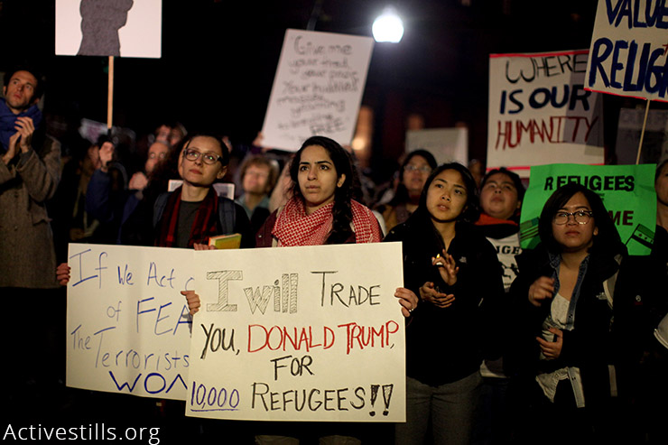 Protesters take part in a vigil against Massachusetts Governor Charlie Baker's opposition to allowing Syrian refugees into the state, held outside the State House in Boston, MA, November 20, 2015. (Activestills.org)