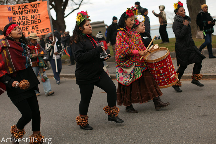 Native Americans and allies take part in the National Day of Mourning rally in Plymouth, MA, November 26, 2015. Every year since 1970, Native Americans and allies have gathered at noon on this day at Cole's Hill in Plymouth to commemorate The National Day of Mourning as others celebrate the U.S. Thanksgiving holiday. (Activestills.org)