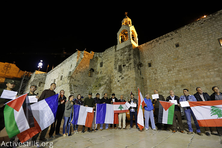Palestinians take part in a solidarity vigil following the deadly attacks in Paris, at Manger Square in front of the Church of Nativity, Bethlehem, West Bank, November 14, 2015. ISIS carried out the deadly terror attacks in different locations in Paris, France, on Friday, November 13, killing over 130 people. (Activestills.org) More on the Paris attacks here and here.