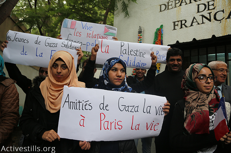 Students of the French department at Al Aqsa University in Gaza City stand in solidarity with the victims of Paris terrorist attacks which left more than 130 people dead, Gaza Strip, November 17, 2015. (Activestills.org) More on the Paris attacks here and here.
