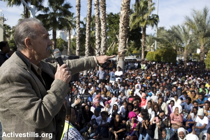 Reuven Abergel, co-founder of the Black Panthers Movement in Israel, speaking to more than 10,000 African asylum seekers gathered in Levinsky Park showing support in their struggle, in south Tel Aviv, Israel, January 7, 2014. (photo: Oren Ziv/Activestills.org)