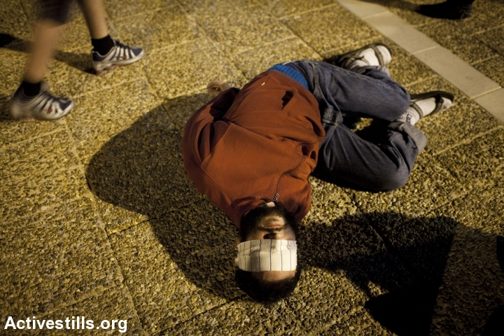 Israeli activists participate in an action protesting the use of torture, 2011. (photo: Oren Ziv/Activestills.org)
