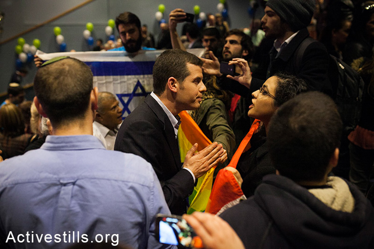 Ronen Shoval of the right-wing Jewish Home party argues with an LGTBQ activist during a conference put on by the party in Tel Aviv University, January 12, 2015. The activists, alongside public housing advocates, disrupted the conference to protest recent homophobic and racist comments by members of the party. Before joining Jewish Home, Shoval was the founder and leader of the far-right group Im Tirzu. (photo:Activestills.org) | For more on Shoval and Im Tirzu, click here.