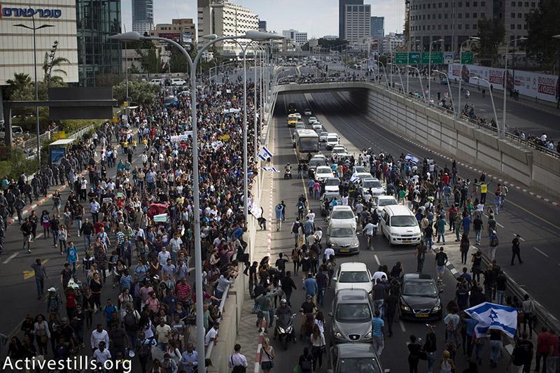 Ethiopian-Israelis march in the direction of Ayalon highway during a protest against police brutality and racism, Tel Aviv, May 3, 2015. The protests erupted following the release of a video showing a policeman brutally beating an Ethiopian-Israeli. (photo: Activestills.org) | Read more about the anti-racism and police brutality protests by Ethiopian-Israelis.