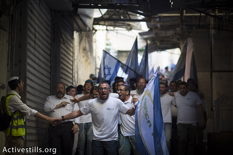 Israel youth are seen chanting during Jerusalem Day's 'March of the Flags.' The march is held every year by Israeli nationalists to celebrate what they view as the 'reunification' of Jerusalem, Jerusalem's Old City, May 17, 2015. The police force Palestinians in the Muslim Quarter to shut down their stores during the march, which often includes violence and racist, anti-Arab chants. (photo: Activestills.org) | For more photos from this year's Jerusalem Day, click here. For background on the daily reality in annexed East Jerusalem, click here.