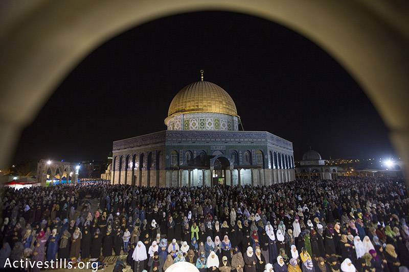 Muslim worshippers pray overnight during Laylat al-Qadr at the Dome of the Rock in the Al-Aqsa compound, Jerusalem's Old City, July 13, 2015. Layal al-Qadr falls on the 27th day of the holy month of Ramadan, marking the night Muslims believe the first verses of the Quran were revealed to the Prophet Mohammed by the archangel Gabriel. (photo: Activestills.org) | Click here for more photos from this year's Ramadan in Palestine and Israel.