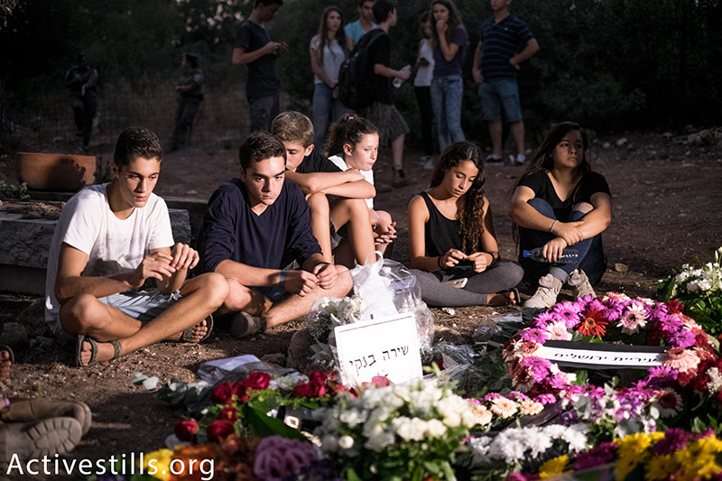Hundreds of friends, classmates, teachers and members of the LBTGQ community participate in the funeral of Shira Banki, Kibbutz Nachshon, August 3, 2015. Banki, 16, was stabbed by an ultra-Orthodox Jew during the Jerusalem Pride Parade, July 30, 2015. The suspect, Yishai Schlissel, was released from prison only weeks prior to the attack, after serving time for a nearly-identical attack during the 2005 Pride Parade.  (photo: Activestills.org) | Click here for the ultra-Orthodox community's response to the murder.