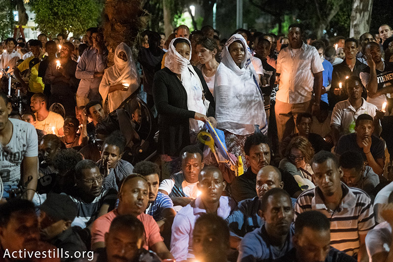 Members of the Eritrean community in Israel mourn Habtom Zarhum, an asylum seeker who was 'lynched' by Israelis after being mistaken for an assailant in an attack that killed an Israeli soldier at Be'er Sheva's central bus station, October 21, 2015. Zarhum, who was kicked by an angry mob after being shot, will not be recognized by the state as an official victim of terrorism. (photo: Activestills.org) | Read more on the vigil for Zarhum here and on Israel's asylum regime here.