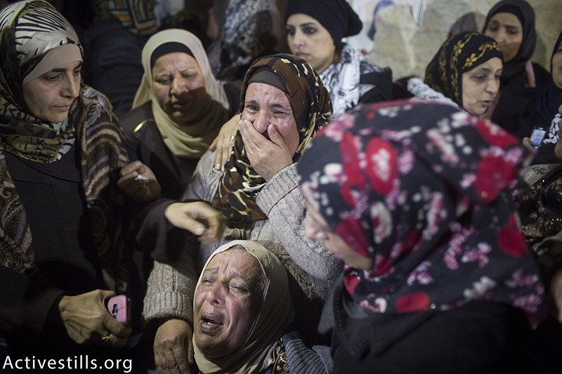 Palestinian women mourn during the funeral of 14-year-old Hadeel Awwad in the Qalandiya refugee camp near Ramallah, December 18, 2015. Hadeel was shot dead by an Israeli police officer after she attempted to stab passersby with scissors in Jerusalem's Mahane Yehuda Market on November 23. After nearly a month, Israeli authorities released Hadeel's body to her family for burial. (photo: Activestills.org) | Palestinians aren't trying to go to heave — they are fleeing hell. Read more here.