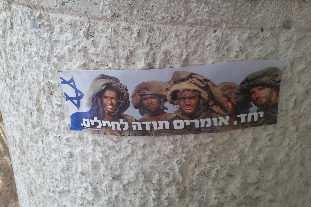 'Together, we say thank you to the soldiers.' Stickers praising Israeli soldiers adorn the streets and alleyways of Jerusalem during the 2014 Gaza war. (photo: Mya Guarnieri)