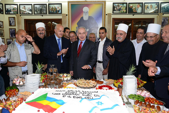 Prime Minister Benjamin Netanyahu visiting members of the Druze community, on the occasion of the Nabi Shueib holiday, at the home of Druze spiritual leader Sheikh Muafak Tareef in Julis and at the Yad LeBanim building in Daliyat al-Karmel, April 25, 2013. (Moshe Milner/GPO, C.C. 2.0)