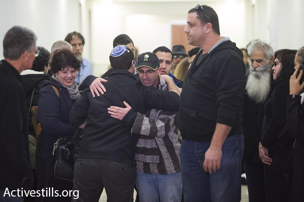 Israeli left-wing activist Guy Butavia greets supporters at the Jerusalem Magistate's Court, January 21, 2016. (photo: Oren Ziv/Activestills.org)