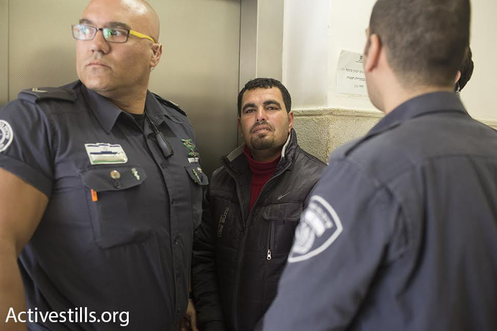 Palestinian anti-occupation activist Nasser Nawajah is led into the Jerusalem Magistrate's Court, January 21, 2016. (photo: Oren Ziv/Activestills.org)