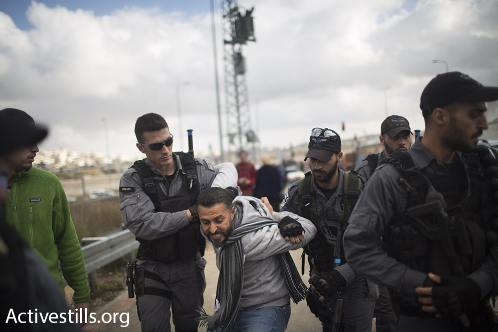 Israeli police arrest a Palestinian organizer of the protest, a member of Combatants for Peace, Beit Jala, West Bank, January 15, 2016. (Oren Ziv/Activestills.org)