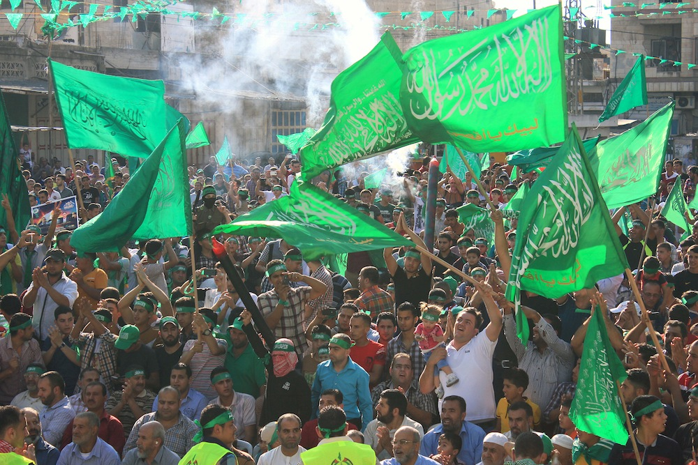 Palestinians demonstrate in support of Hamas during the 2014 Gaza war, in the West Bank city of Nablus, three days after a deal signed by Israel and Hamas ended the 51-day war, August 29, 2014. (photo: Activestills.org)