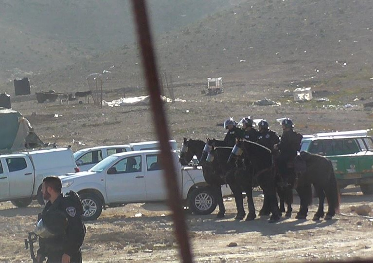 Israeli police forces look on as bulldozers destroy a mosque in the unrecognized Bedouin village of Rakhamah, January 6, 2016. (photo: Salimah Sarahin NCF/HRDN).