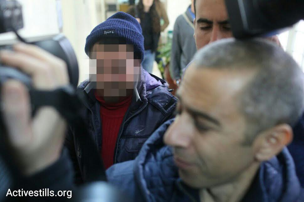 The Palestinian activist who was arrested Tuesday night is brought to the Jerusalem Magistrate's Court. (photo: Activestills.org)