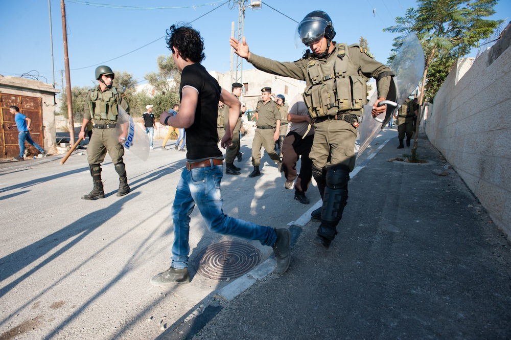 Palestinian Authority police attempt to prevent youth in Aida Refugee Camp from clashing with Israeli forces, Bethlehem, West Bank, September 27, 2013. The clashes were in reaction to recent provocations at Jerusalem's Al Aqsa Mosque by right-wing Jewish settlers. (photo: Activestills.org)