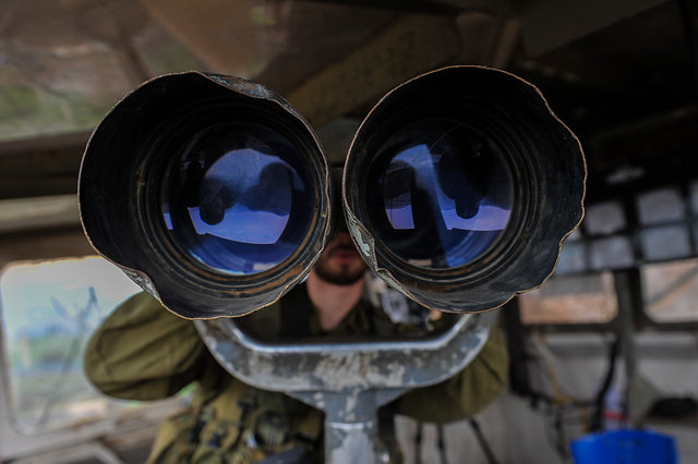 Illustrative photo of an Israeli soldier looking through high powered binoculars, by IDF Spokesperson.