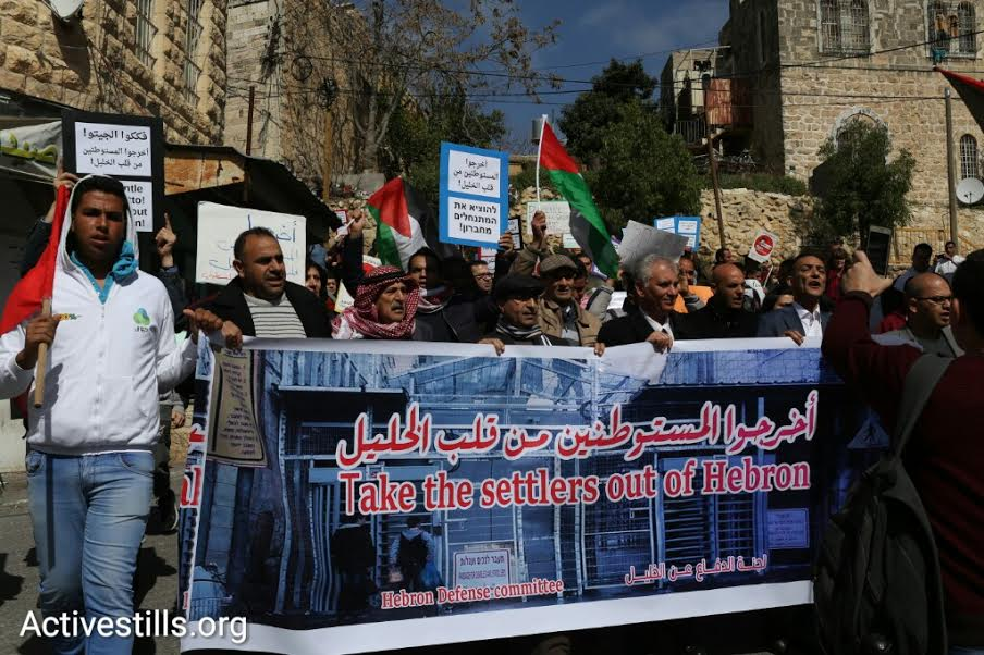 Palestinian members of the Hebron Defense Committee protest in central Hebron, calling on Israeli authorities to open Shuhada Street, which has been off limits to Palestinians since the Second Intifada. (photo: Oren Ziv/Activestills.org)