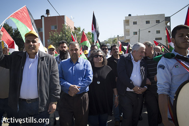 MK Aida Touma-Suleiman marches through Bil'in at a protest marching 11 years of popular struggle, February 19, 2016. (Oren Ziv/Activestills.org)