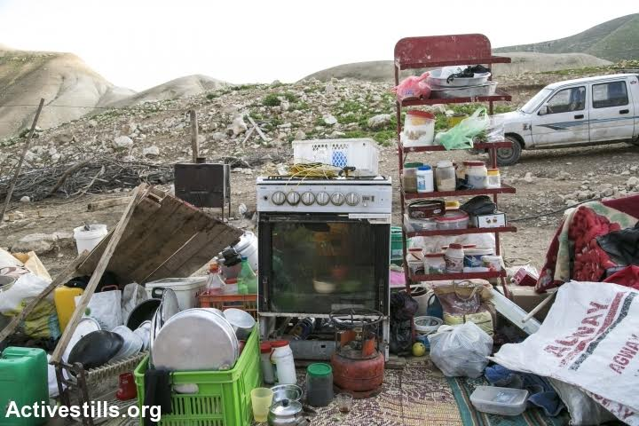 The belongings of a Palestinian family seen following demolitions in Karzalya, Jordan Valley, West Bank, February 11, 2016. (photo: Activestills.org)