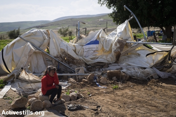 A child sits next to her demolished shack, provided by the EU in the village of Fasayil in the Jordan Valley, West Bank on February 10, 2016. On that day Israeli authorities conducted mass demolitions in four areas in the Jordan Valley. Seven family houses and six animal shelters were demolished, leaving 71 people without a roof over their heads. In addition, a water pipes system that provide water to 300 people was deliberately damaged. (Activestills.org)