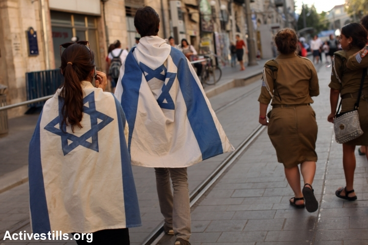 Young Israelis march during the annual Jerusalem Day March held by Israelis to celebrate 48 years since Israel conquered East Jerusalem, outside Jerusalem's Old City, May 17, 2015. (photo: Tess Scheflan)