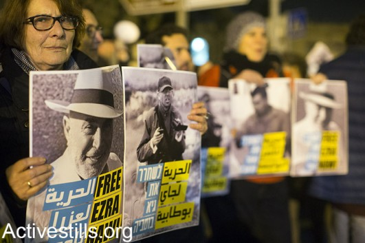 Israeli left-wing activists protest outside the Russian compound police station in West Jerusalem, calling to release the three anti-occupation activists under arrest at the time: Ezra Nawi, Guy Butavia and Nasser Nawaja, on January 21, 2015. (Activestills.org)