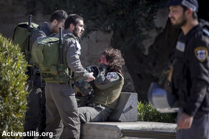 An Israeli Border Policewoman at the scene where three Palestinians carried out a shooting attack outside Damascus Gate in Jerusalem's Old City. The three were immediately shot dead by Israeli security forces, February 3, 2016. (photo: Faiz Abu Rmeleh/Activestills.org)