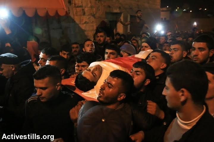 Palestinians carry the body of Ahmed Zakarneh, one of the three Palestinians killed during the shooting attack on Israeli Border Policemen in Jerusalem's Old City, Qabatiya, West Bank, February 5, 2016. (photo: Ahmad al-Bazz/Activestills.org)